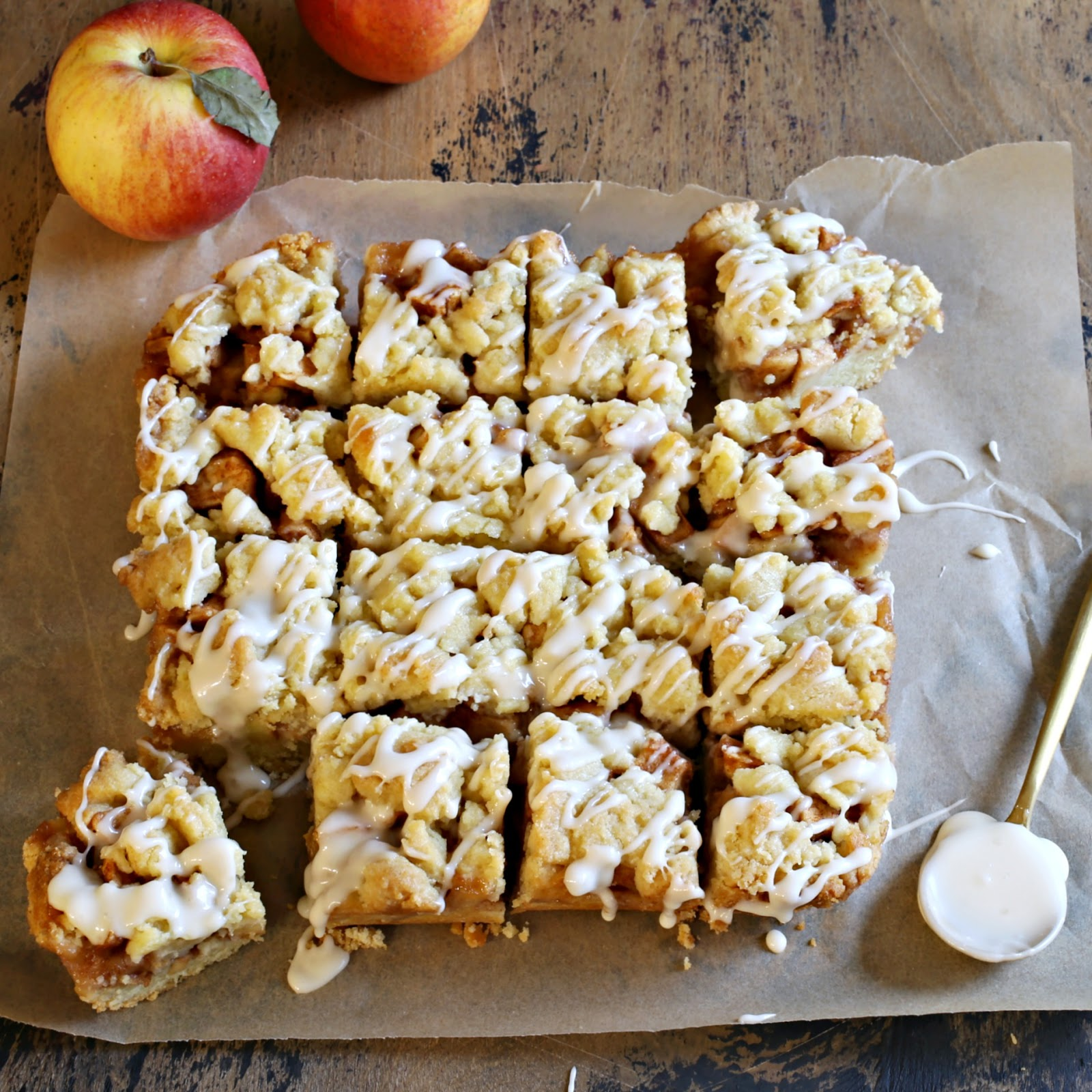 Recipe for shortcrust dessert bars filled with cinnamon apples and topped with maple glaze.