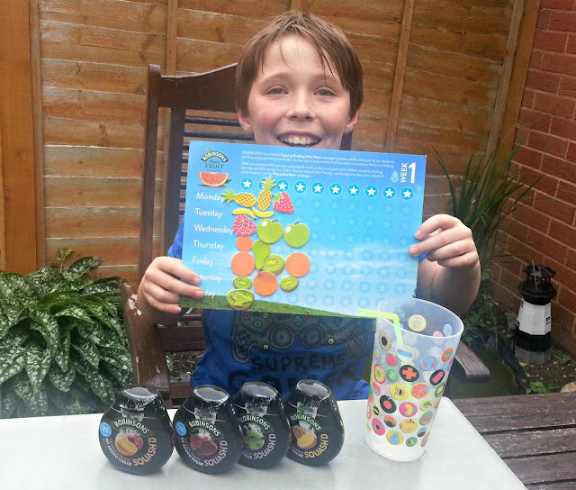 Boy with Robinsons sticker chart