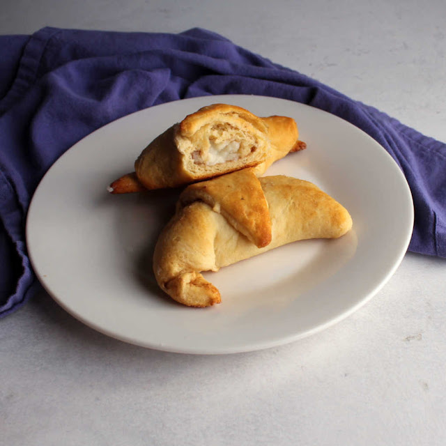 small plate with cream cheese stuffed crescent roll danishes for breakfast