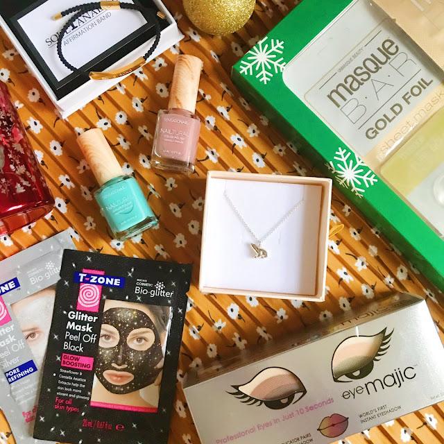 flatlay - T-Zone glitter face masks, Eye Majic instant eyeshadow, MasqueBAR gold gift set, Jana Reinhardt necklace, Sensationail nail polishes