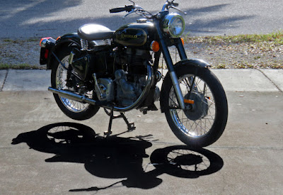 Royal Enfield Bullet with kick starter visible.