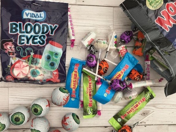 Pack of sweets that look like eyes, a mixed back of sweets some in Halloween wrappers,eyeball chocolates