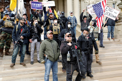 Photo of armed white supremacists terrorists occupying Michigan's state house in a pro-coronavirus demonstration.