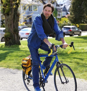 Carlo Marks riding a bicycle