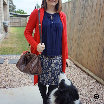 awayfromtheblue Instagram monochrome navy office pencil skirt blouse outfit with red cardigan