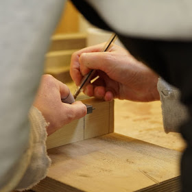 Image of someone marking out a woodworking joint