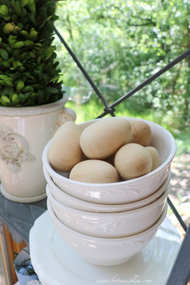 French Country Sunspace Update with natural color wooden eggs for spring decor