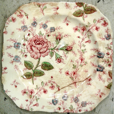 antique China plate with roses and other flowers