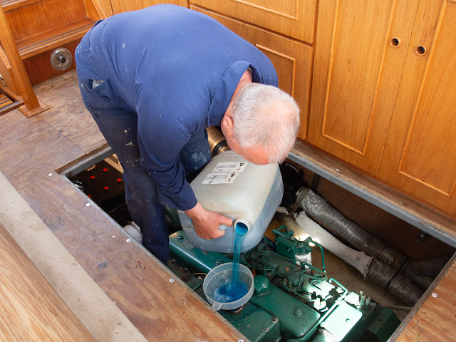 Photo of Phil pouring the antifreeze and water mixture into Ravensdale's port engine