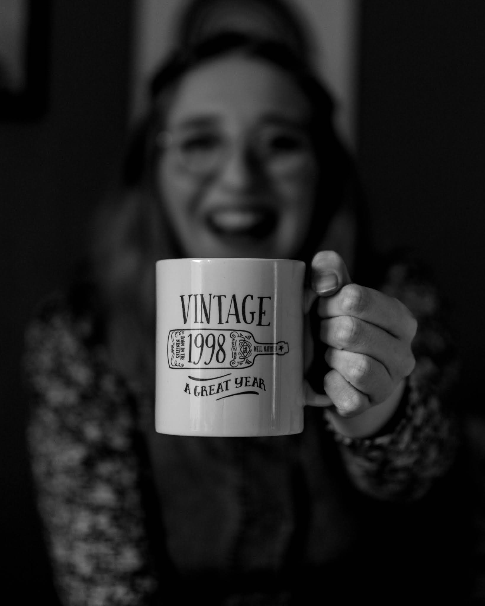 black and white photo of mug saying 'vintage 1998 a great year'