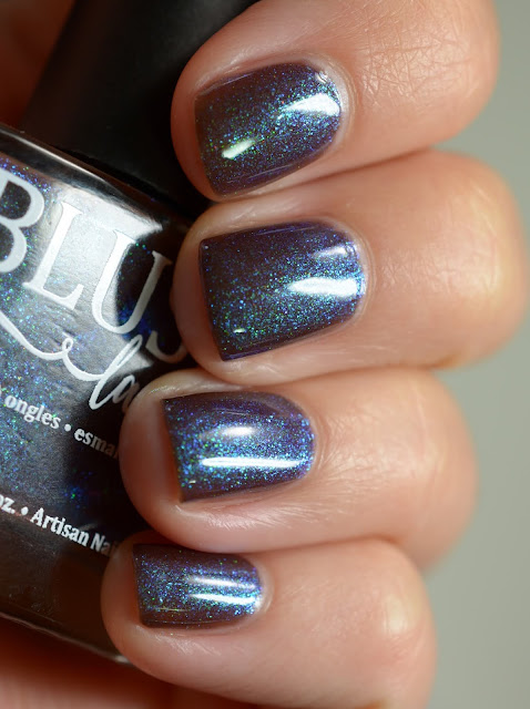 Murky brown purple nail polish that shifts to blue and green
