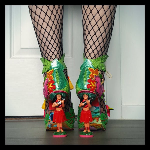 back view of hula girl heels with red grass skirts and floral uppers