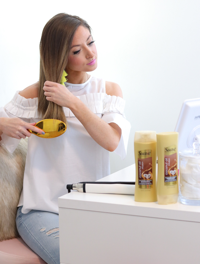 brushing hair out with suave hair gold shampoo and conditioner
