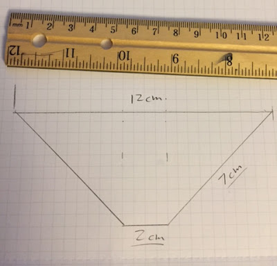 Tape the 4 clear plastic trapezoid pieces together as shown below