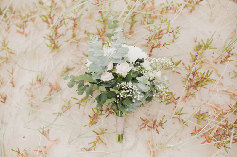bride bouquet on sand dune