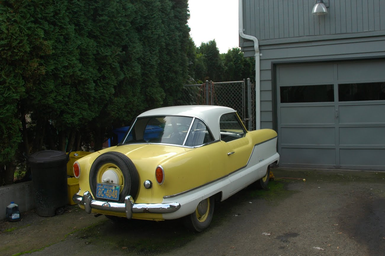 OLD PARKED CARS.: 1956 Nash Metropolitan