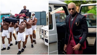 Lagos socialite Pretty Mike storms event on the shoulders of 6 hefty men (photos)