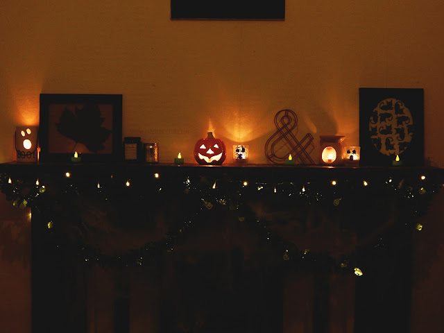 Mantelpiece covered in Halloween Decorations.