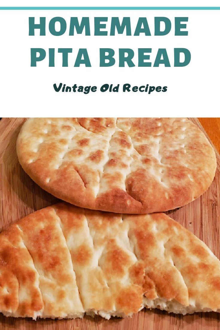 this is homemade pita bread on a wooden board and made for Pinterest