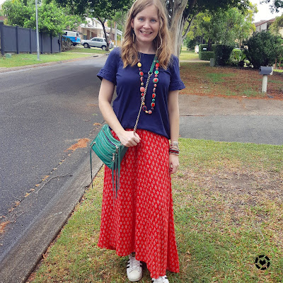 awayfromblue Instagram | red printed maxi skirt with green accessories for Christmas with navy frill sleeve tee