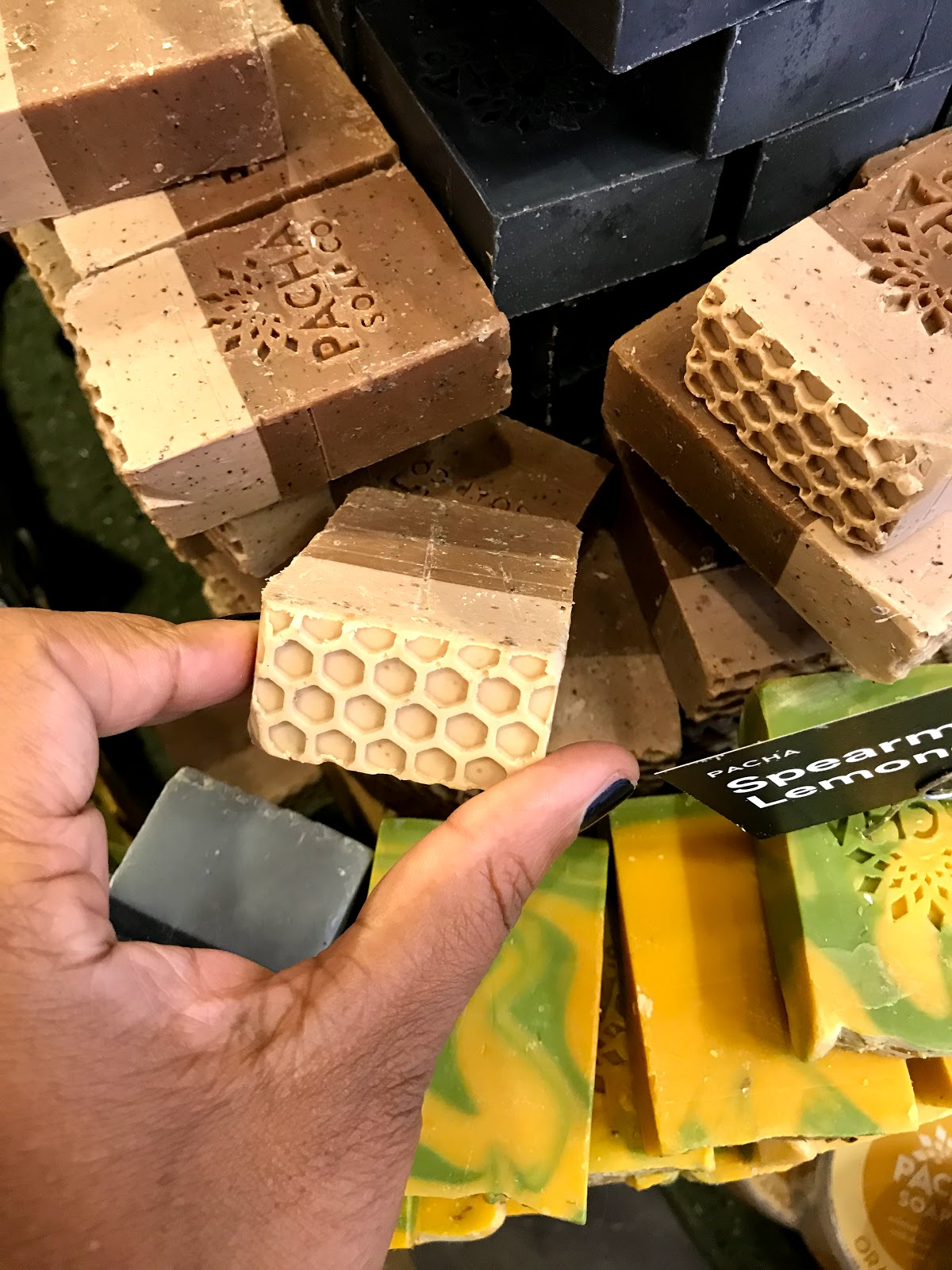 Image:Tangie Bell buys natural bee soap from Whole Foods Grocery store.