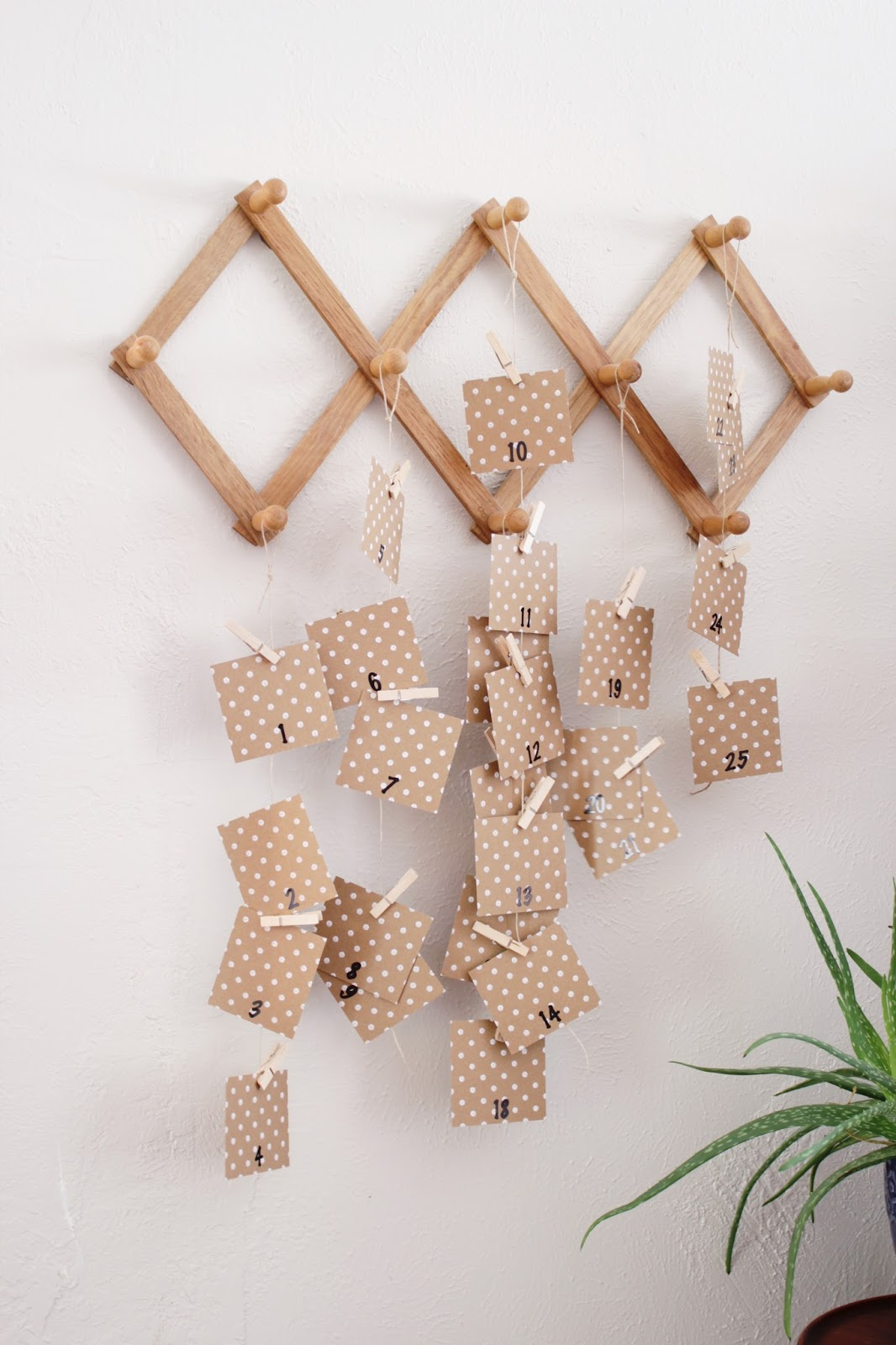 This Christmas Advent calendar wall hanging is a simple way to countdown and enjoy the season with your kids.