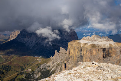 Hike 4 - View from Sass Pordoi with part of Sella Group (in sun), Passo Sella, and Langkofel Group (in clouds).