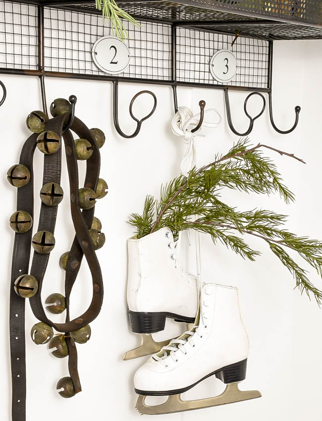 vintage sleigh bells and white skates with greenery