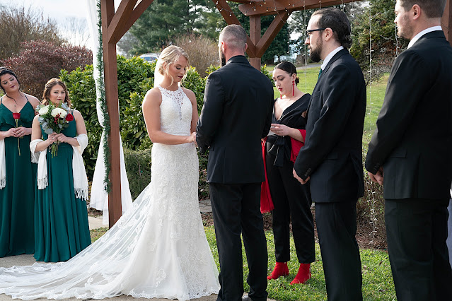 Ceremony Bride and Groom exchanging vows Magnolia Farm Asheville Wedding Photography captured by Houghton Photography