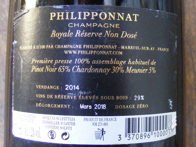 Details of the requirements to mention winemaker, location, vintage, sugar levels and professional reference code number on champagne labels. Photo taken by Susan from Loire Valley Time Travel.