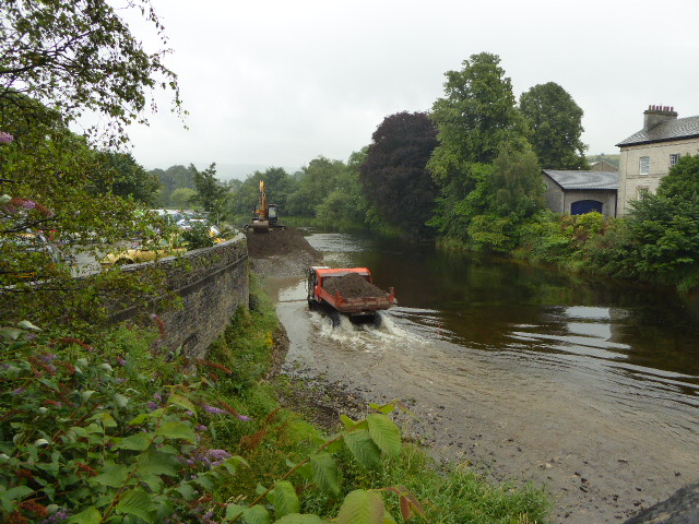 Off The Bus We Saw This A Caterpillar Tractor Thingy Moving Earth In The River Like So Much Of This Part Of The World Kendal Suffered Very