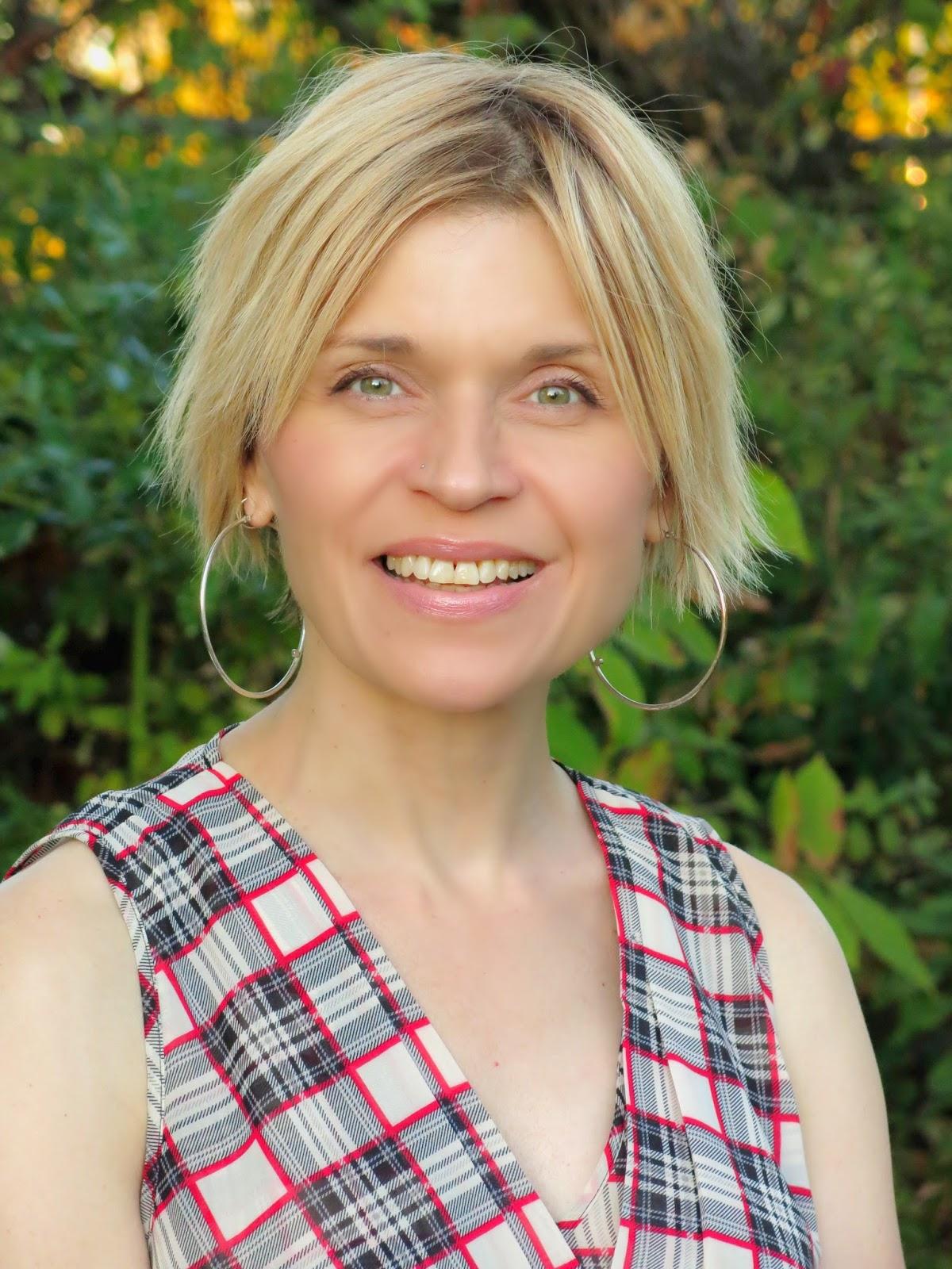 sleeveless plaid blouse, oversized hoop earrings