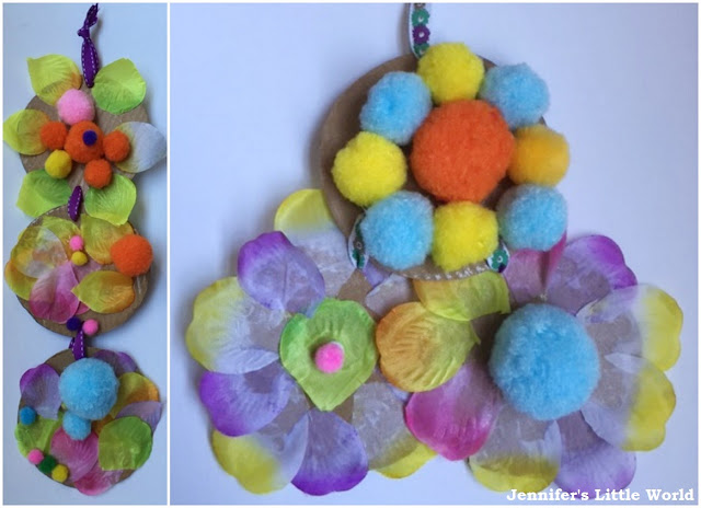Spring window craft with pom poms