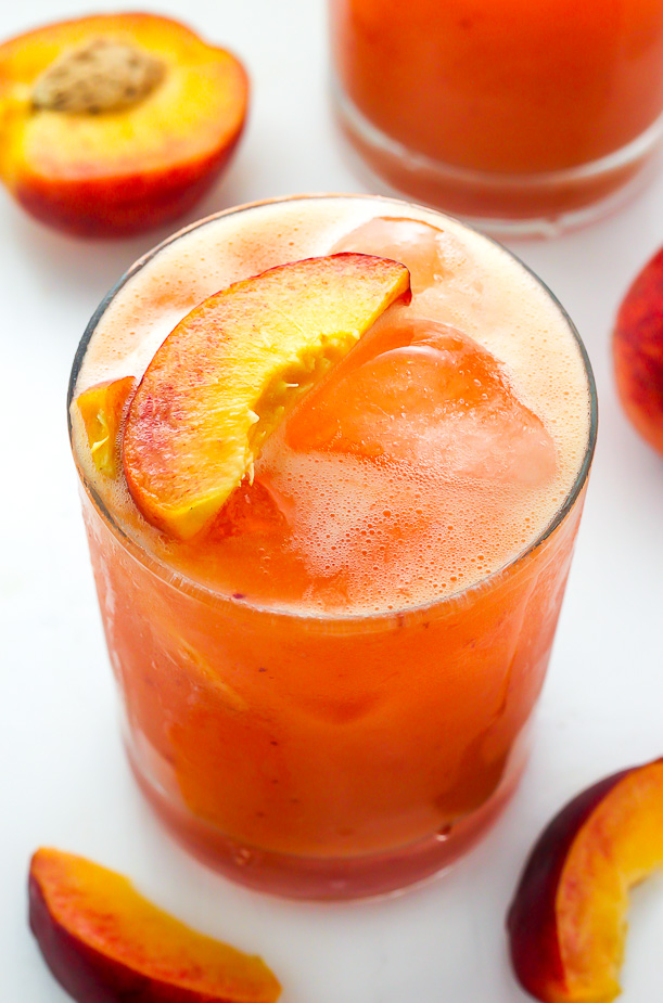 Fun and fruity Fresh Peach Margaritas!!! Made with fresh peach puree, orange juice, and lime juice. They're so refreshing and the perfect Summer cocktail!