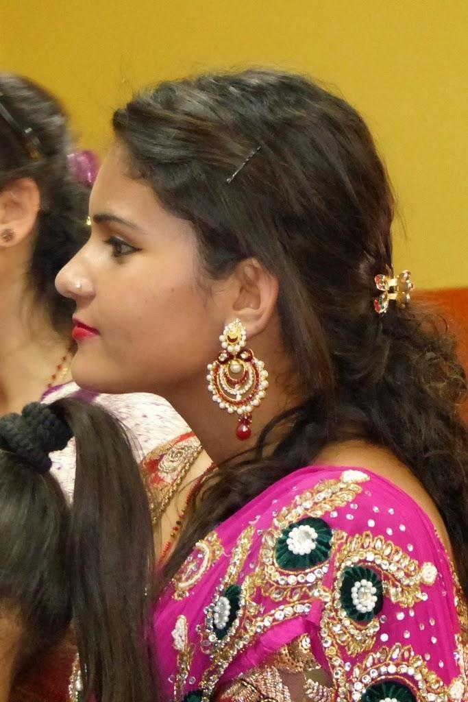 Young girl wearing large earrings