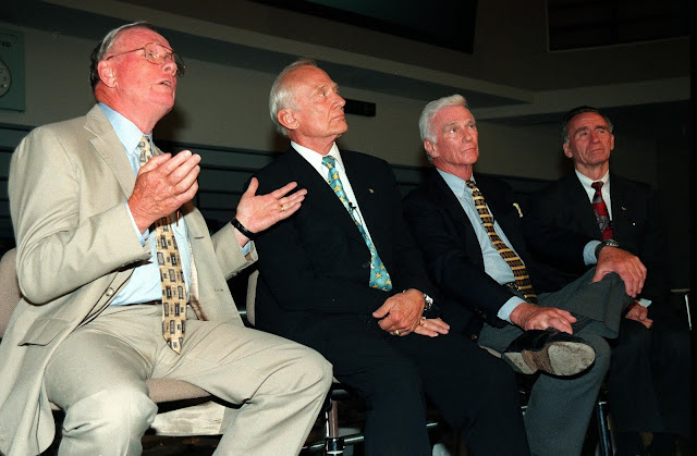 """KENNEDY SPACE CENTER, FLA. -- Former Apollo astronauts meet with the media at the Apollo/Saturn V Center prior to an anniversary banquet highlighting the contributions of aerospace employees who made the Apollo program possible. From left are Neil A. Armstrong and Edwin """"Buzz"""" Aldrin who flew on Apollo 11, the launch to the moon; Gene Cernan, who flew on Apollo 10 and 17; and Walt Cunningham, who flew on Apollo 7. This is the 30th anniversary of the launch and moon landing, July 16 and July 20, 1969. Neil Armstrong was the first man to set foot on the moon"""