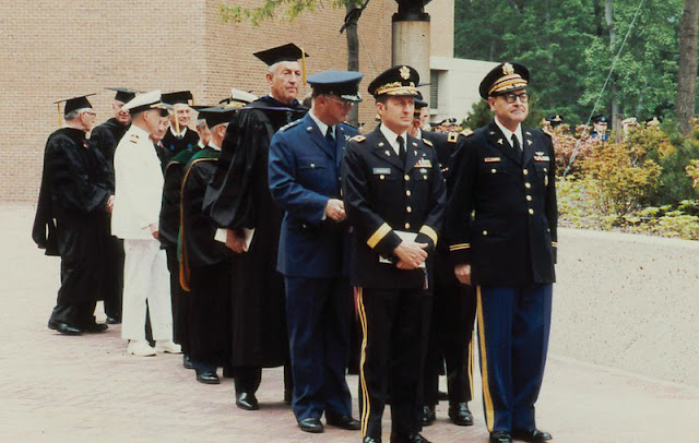 USU's first Commandant of Students, Army Col. (Dr.) Robert Joy (right), leads the faculty procession for the University's first Commencement in 1980.  (Uniformed Services University photo)