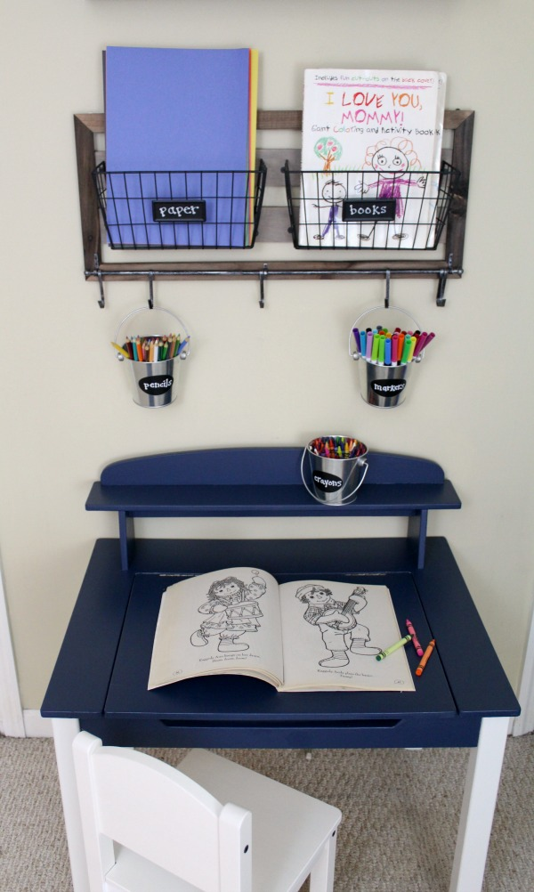 Organized art station for kid's art and craft supplies: Use tin buckets for easy supply storage