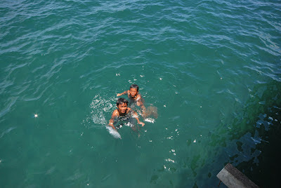 Kids swimming in the sea near Floating Restaurant at Baybay Leyte