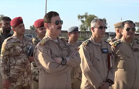 Image Attribute: Iraqi Air Force's commander Lieutenant General Hama Amin and his team witnessing the F-16 delivery ceremony at Balad Air Base, April 6, 2019. / Source: Screengrab from the video released by Iraqi Security Media Center.