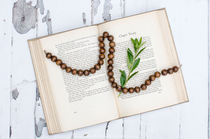 Dark wood bead bracelet on vintage book