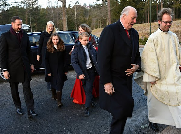 Crown Prince Haakon, Crown Princess Mette-Marit, Prince Sverre Magnus, Princess Ingrid Alexandra attend Christmas service. Crown Princess Mette-Marit wore Prada coat