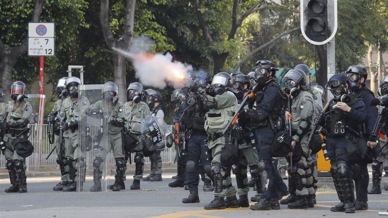 Hong Kong police shoot protester as violent clashes escalate