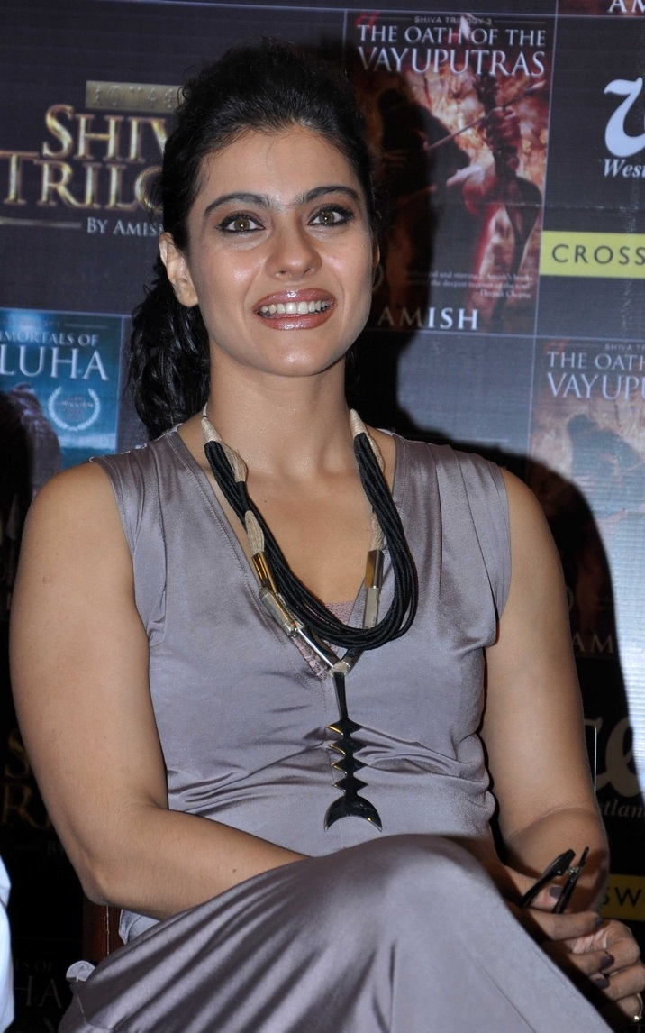Indian Hot Actress Kajol Smiling Face Photos In Sleeveless Dress At Music Launches