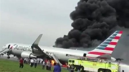 American Airlines plane catches fire at Chicago Airport, 8 injured