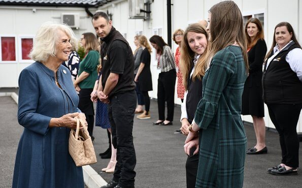 The Duchess of Cornwall wore a denim dress from Fiona Clare, and a neutral handbag and shoes. She wore her FitBit watch and some gold jewellery