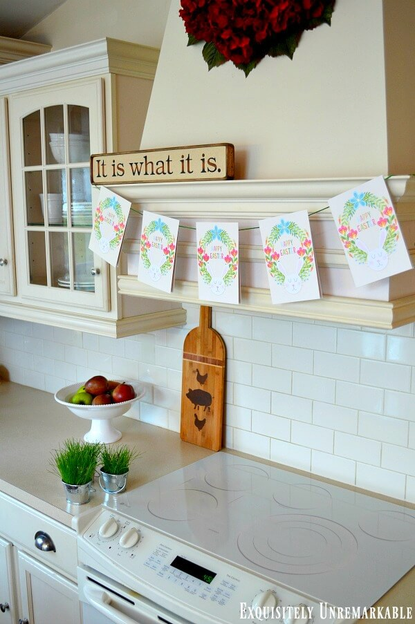 Easter Card Banner hanging on wooden kitchen hood over white stove