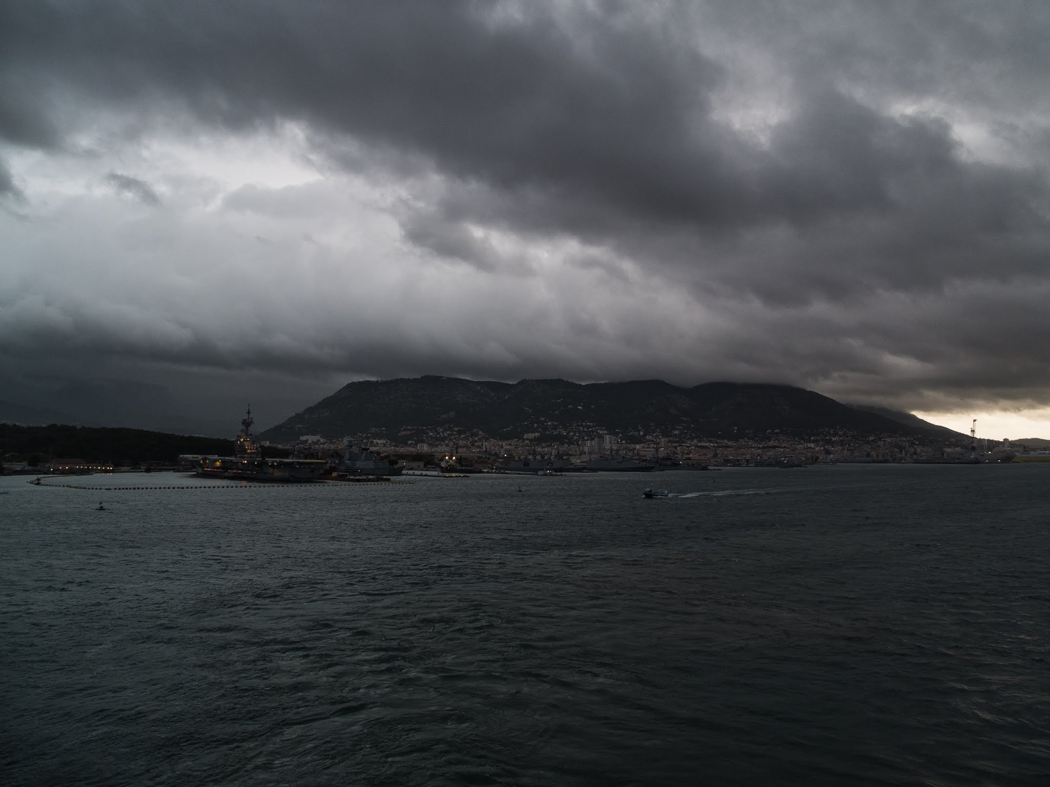 Dark clouds at sunrise in Toulon harbour.
