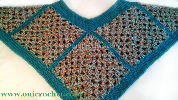 Beginner crochet poncho made with granny squares, a simple trim, and a reverse single crochet accent. Designed by #OuiCrochet