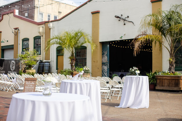 ceremony and cocktail tables in front of Artisan Alley